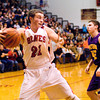 Borden senior Garrett Vick comes up with a rebound during the Braves' home game against Eastern on Tuesday. Staff photo by Christopher Fryer