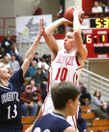Jeffersonville junior Drew Ellis shoots a jumper against Evansville Reitz on Friday night. Staff photo by C.E. Branham