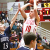 Jeffersonville junior Drew Ellis shoots a jumper against Evansville Reitz on Friday night. Staff photo by C.E. Branham