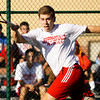 Jeffersonville junior Austin Hunt moves to return a shot to Floyd Central senior Ryan Plunkett during their No. 1 singles match in the final round of the Floyd Central Regional on Wednesday. Hunt won the match in 3 sets, 6-0, 2-6, 6-2. Staff photo by Christopher Fryer