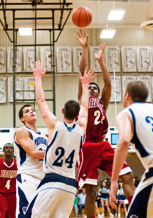 Jeffersonville senior Darryl Baker goes up for a shot during their away game against Providence on Saturday. Jeffersonville won the game, 59-56. Staff photo by Christopher Fryer