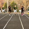 New Albany and Floyd Central runners compete in the 200-meter dash during their meet at New Albany on Tuesday. Staff photo by Christopher Fryer