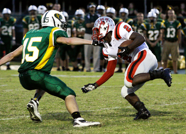 Floyd Central defensive back Grant Foster attempts to stop Jeffersonville running back Austin Hines during the second quarter of their game at Floyd Central on Friday. Staff photo by Christopher Fryer