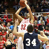 Jeffersonville junior Keenan Williams scores in the paint against Bedford North Lawrence Friday night in Seymour. Staff photo by C.E. Branham