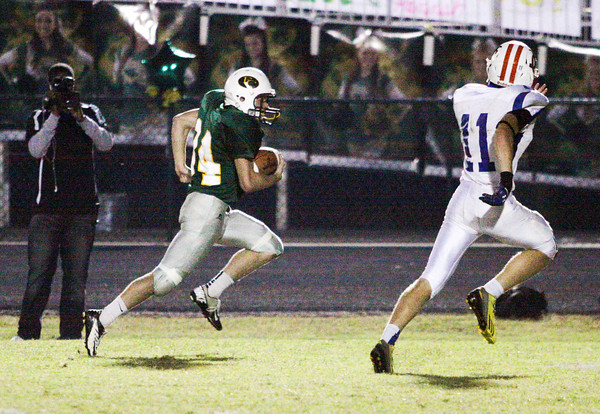 Floyd Central running back Gaige Klingsmith moves the ball downfield on a touchdown run during their home game against Jennings County on Friday. Staff photo by Christopher Fryer