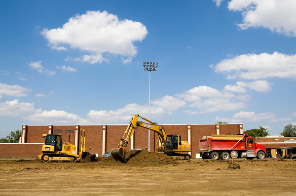 Crews with Hilltop Farms Excavating, out of West Newton, work to remove the existing natural turf at New Albany's Buerk Field on Thursday afternoon. Synthetic turf is scheduled to be installed at the stadium, as well as at Floyd Central's Weigleb Stadium. Staff photo by Christopher Fryer