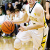 Floyd Central guard Austin Newell moves the ball down court during the Highlanders' home game against New Albany on Friday. New Albany won the game 49-45. Staff photo by Christopher Fryer