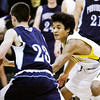 Floyd Central guard Allen Truong covers Providence guard Cory Cahalan during their game at Floyd Central on Saturday. Providence won the game, 43-31. Staff photo by Christopher Fryer