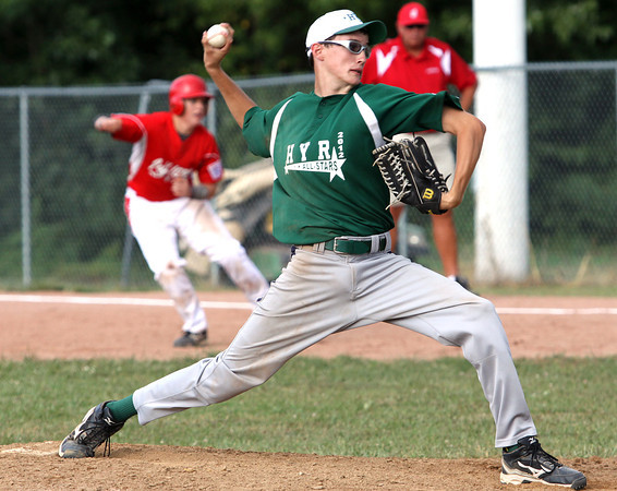 HYR 13-14 All-Star Cameron Harvey delivers a pitch to the Jeff/GRC All-Stars in District V tourney pool play Friday night in Charlestown. Staff photo by C.E. Branham