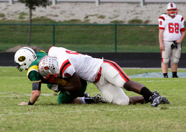 Jeffersonville junior Dionte Allen sacks Floyd Central senior Bryce Smith during the first quarter of their game at Floyd Central on Friday. Staff photo by Christopher Fryer