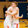 Silver Creek guards Nick Tinsley, right, and Gabe Bauer celebrate the Dragons' 37-36 victory over Brownstown in the championship round of the North Harrison Sectional on Saturday. Staff photo by Christopher Fryer
