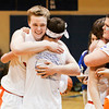 Silver Creek center Christian Reed celebrates with fans following the Dragons' 37-36 victory over Brownstown in the championship round of the North Harrison Sectional on Saturday. Reed hit two free-throws in the last seconds of the game to take the lead and seal the win for Silver Creek. Staff photo by Christopher Fryer