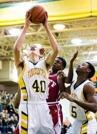 Floyd Central freshman Trevor Apple comes down with a rebound during the Highlanders' home game against Jeffersonville on Friday. Floyd Central won the game, 71-70. Staff photo by Christopher Fryer