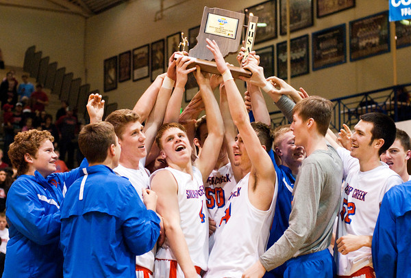 Silver Creek players celebrate following the Dragons' 37-36 victory over Brownstown in the championship round of the North Harrison Sectional on Saturday. Staff photo by Christopher Fryer