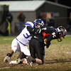 Charlestown defender Seth McCutchen sacks Brownstown quarterback Clay Borwn in the first half. Staff photo by C.E. Branham