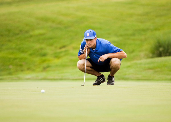 Silver Creek's Sam Garr studies the green before putting on the 18th hole during the Providence Sectional at Covered Bridge Golf Club on Monday. Staff photo by Christopher Fryer