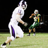 Floyd Central quarterback Colton Kimm moves to pass during their home game against Seymour on Friday. Staff photo by Christopher Fryer