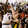 New Albany center Anthony Edwards goes up for a shot during their home game against Floyd Central on Friday. Staff photo by Christopher Fryer