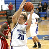 Charlestown senior Chris Braun cuts to the basket against Jeffersonville on Tuesday night. Staff photo by C.E. Branham