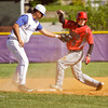 Borden sophomore Kyle Kruer makes it safely to third base on an RBI triple during their game against New Washington in the Lanesville sectional tournament on Friday. Staff photo by Christopher Fryer