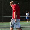 Jeffersonville sophomore Brock Winchell reacts following his loss to Jasper junior Grant Weaver after their No. 2 singles match at the Jasper Semistate on Saturday. Staff photo by Christopher Fryer