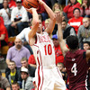 Jeffersonville forward Drew Ellis shoots a three against Ballard Tuesday night. Staff photo by C.E. Branham