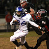 Charlestown receiver Cody Donahue picks up yards against Brownstown Central. Staff photo by C.E. Branham