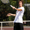 New Albany junior Jake Kennard returns a shot during his No. 1 doubles match with junior Tanner Goller against Providence freshman Ben Arnson and junior Ryan Day at the New Albany Boys' Tennis Invitational on Saturday. Staff photo by Christopher Fryer