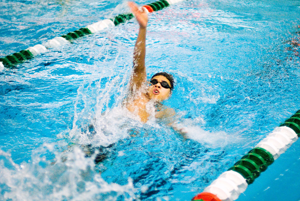 Floyd Central freshman Alex Epps competes in the 100-yard backstroke during the Highlanders' meet against Jeffersonville at Highland Hills Middle School on Thursday. Epps finished in sixth place. Staff photo by Christopher Fryer
