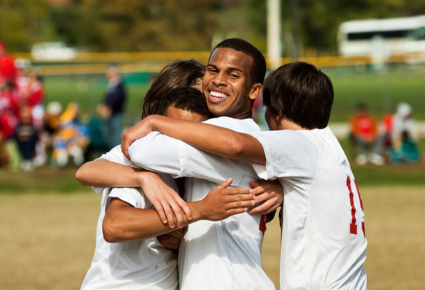 Jeffersonville defender Chase Scott celebrates with his teammates after their 4-1 victory over Corydon Central in the championship game of the Boys Soccer Sectional tournament at Floyd Central on Saturday. Staff photo by Christopher Fryer
