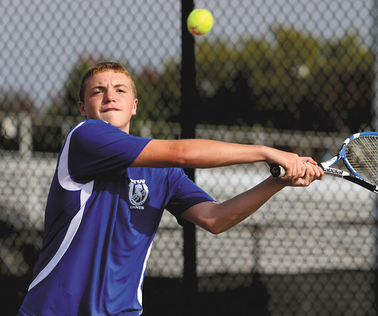 New Washington No. 2 singles player Logan Miles chases down a return from Jeffersonville player Austin Hunt in the Jeffersonville Tennis Sectional finals Thursday. Staff photo by C.E. Branham