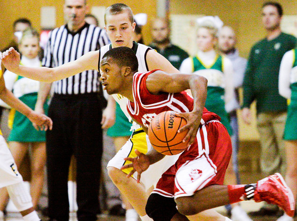 Jeffersonville junior Chad Hudson moves the ball down court during the Red Devils' game at Floyd Central on Friday. Floyd Central won the game, 71-70. Staff photo by Christopher Fryer