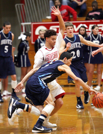 Jeffersonville junior Keenan Williams pressures Evansville Reitz guard Malik Higgins Friday night. Staff photo by C.E. Branham