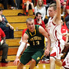 Floyd Central sophomore Colton Kimm drives baseline against Drew Ellis at Jeffersonville Friday night. Staff photo by C.E. Branham