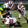 The Jeffersonville defense brings down Floyd Central wide receiver Collin Engle during the second quarter of their game at Floyd Central on Friday. Staff photo by Christopher Fryer