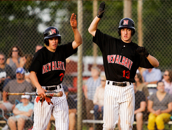 New Albany's Jarius McClure, left, and Tanner Robison celebrate after they both scored during the Bulldogs' 3-0 home win over Providence on Thursday. Staff photo by Christopher Fryer