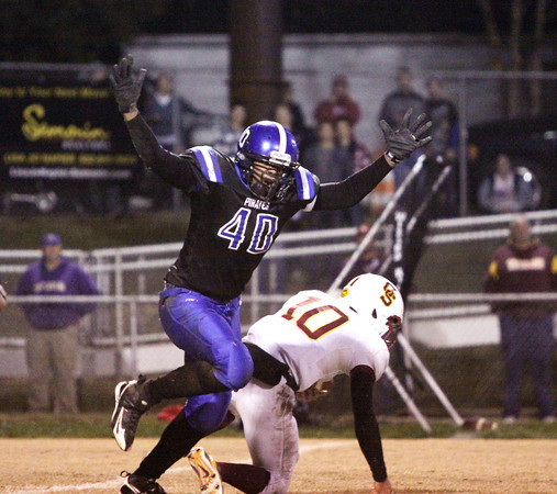 Charlestown defender Desmond Wiley sacked Gibson Southern quarterback  Jordan Scheller in the first half. Staff photo by C.E. Branham