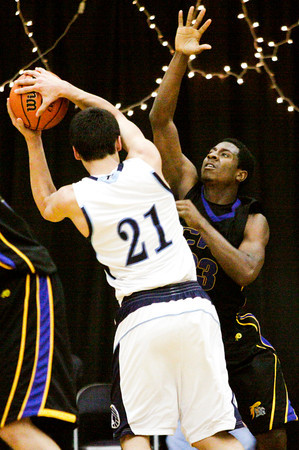 Christian Academy senior DeVonta King guards Providence center Ryan Pickerrell during their game at Providence on Friday. Staff photo by Christopher Fryer