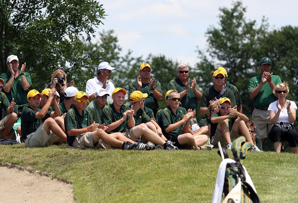 Floyd Central players, fans and coaches applaud as Daniel Shepard finished his round at even par in the IHSAA State Golf Finals on Wednesday. Staff photo by C.E. branham