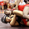 Jeffersonville wrestler Jasi Courer, top and New Albany wrestler Damon Dillon grapple in the 113 pound class Wednesday night at New Albany. Courer won the match by a pin. Staff photo by C.E. Branham