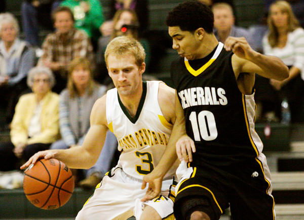 Floyd Central guard Drew Hussung attempts to move past Clarksville guard D.J. Coleman during their game at Floyd Central on Tuesday. Clarksville won the game, 43-41. Staff photo by Christopher Fryer