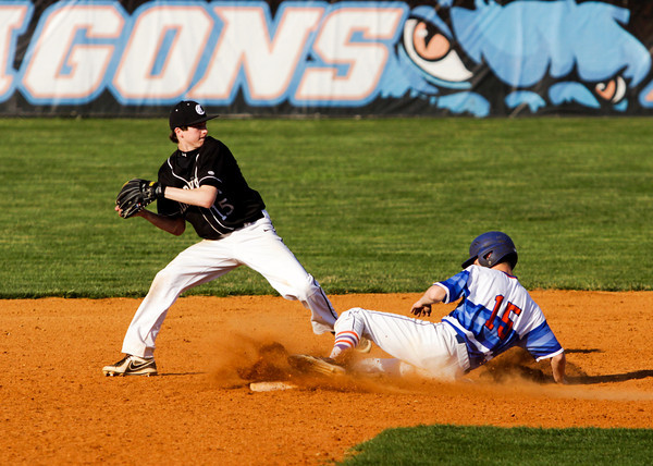 Silver Creek junior Bradley Grimes is forced out at second base by Clarksville sophomore Cody Leonhardt during their game in Sellersburg on Thursday. Silver Creek won the game in five innings, 14-0. Staff photo by Christopher Fryer