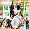 New Albany forward DeAnthony Warren goes up for a shot during the Bulldogs' game at Floyd Central on Friday. New Albany won the game 49-45. Staff photo by Christopher Fryer