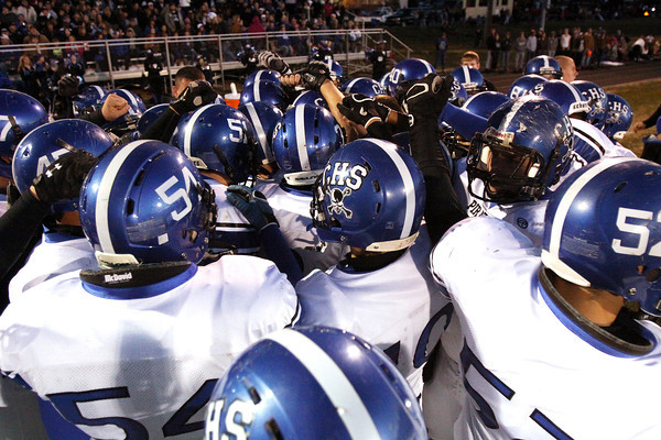 The Charlestown Pirates come together before taking the field against Brownstown Central Friday night. Staff photo by C.E. Branham