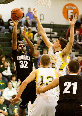 Clarksville forward Jermargio Smith rises up for a shot during their game against Floyd Central at Floyd Central on Tuesday. Clarksville won the game, 43-41. Staff photo by Christopher Fryer