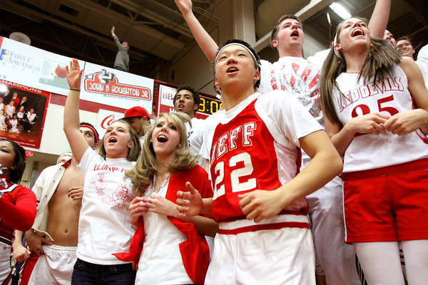 The Jeffersonville student section had plenty to cheer about as the Red Devils cruised past rival New Albany 70-46 Friday night at William S. Joihnson Arena. Staff photo by C.E. Branham
