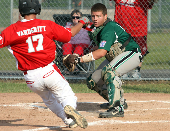 HYR 13-14 All-Star catcher Seth Cordial waits to put the tag on Jeff/GRC runner Christian Vandgrift Monday evening in Distirct V play at Charlestown. Staff photo by C.E. Branham