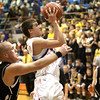Silver Creek junior Gabe Bauer puts up a shot in the lane against Henryville Tuesday night. Staff photo by C.E. Branham