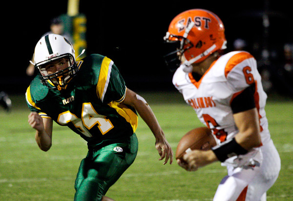 Floyd Central defensive back Gaige Klingsmith runs down Columbus East quarterback Alex Cowan during the second quarter of their game at Floyd Central on Friday. Staff photo by Christopher Fryer