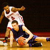Rock Creek guard Joe Logsden and Charlestown guard Chris Braun scramble for a loose ball during their game at Rock Creek on Tuesday. Staff photo by Christopher Fryer